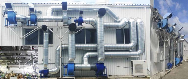 фасад с установленной системой вытяжной вентиляции производства в г. Боярка, Украина